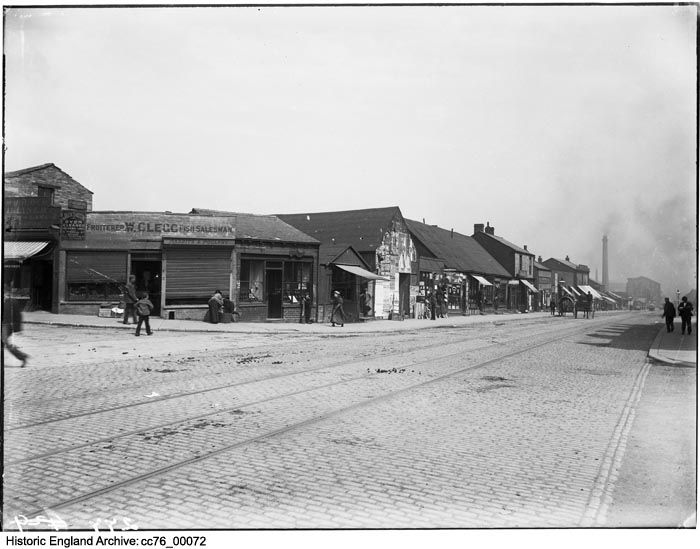 CC76/00072 A view looking east along the north side of Thornton Road from the corner with Ingelby Road, showing William Clegg's fruit and fish shop at number 430. Thornton Road, Manningham, Bradford.  Description The original register identifies the site as 'Bradford Spare lands and shops'.  Date 1890 - 1900 Photographer: London Midland and Scottish Railway