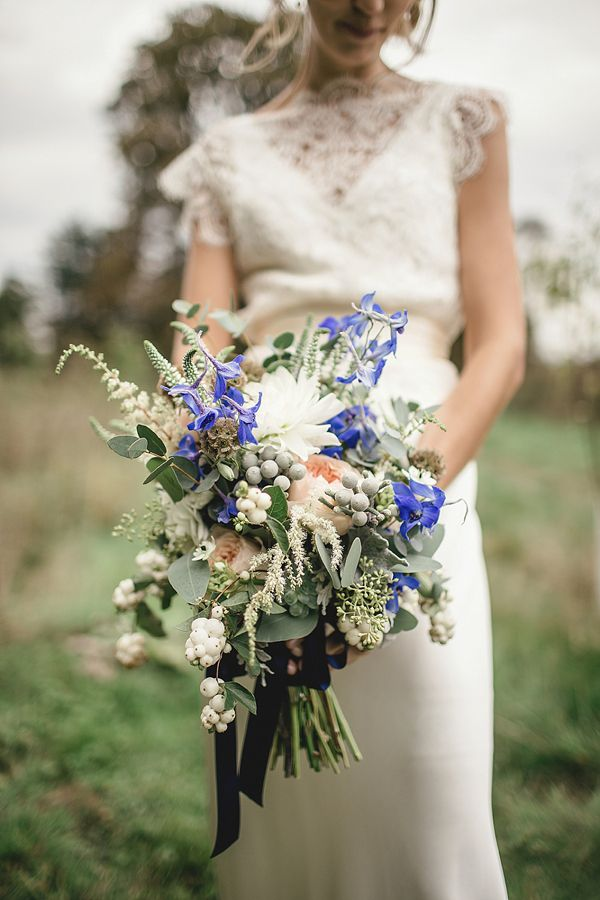 A Sweet September Wedding With Touch Of 1930 S Glamour Pom Poms Peach Gold And Blue