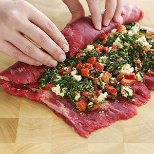 flank steak stuffed with spinach, blue cheese & roasted red peppers..........yummmmmmmm.....this will be made but im thinking with feta cheese and sun dried tomatoes and of course the spinach still. (