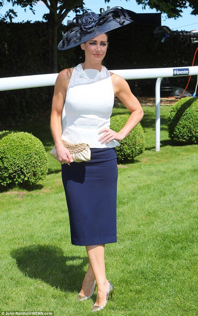 Hot to trot: Kirsty Gallacher looked demure at the Epsom Derby in an elaborate floral hat ...