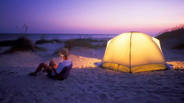 At twilight, the sky turns purple at Hammocks Beach State Park -- 1,145 acres of land that consists mainly of Bear Island along the Southern Outer Banks. Take a 15-minute ferry ride or kayak over to the state park, pitch a tent behind the dune line, and enjoy time to yourself, as well as ample opportunities for fishing (puppy drum, flounder, trout and blue fish are frequent catches).