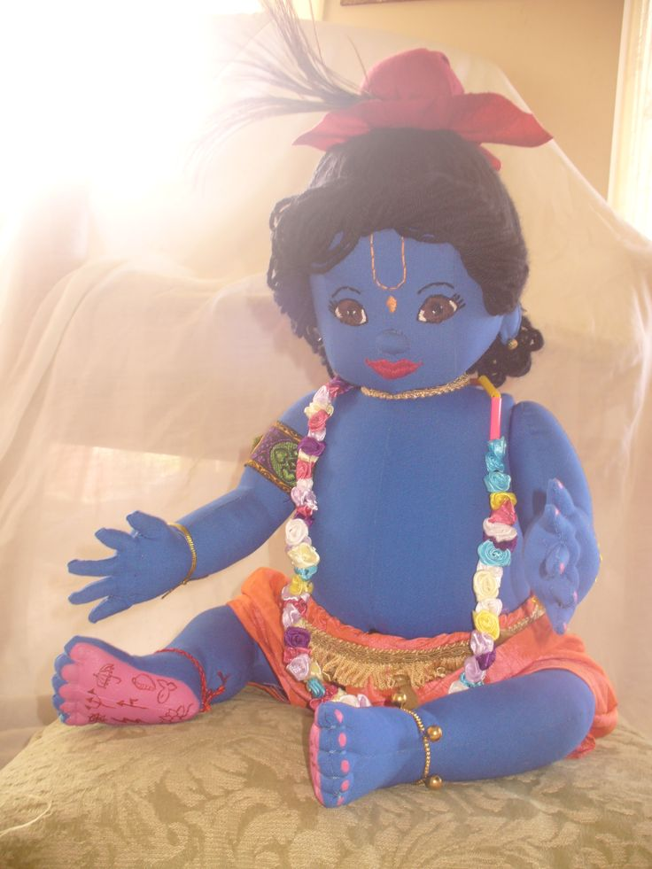 Hand made Baby Krishna Doll....  His face is embroidered.  His arms, slightly bent and legs with bent knees, can move up and down and his head also turns.  His hands have little dimples between his knuckles to emphasize chubbiness with pink finger nails. His feet have little stitched toes, symbols on his painted pink feet and pink toenails.    made with much love and dedication!