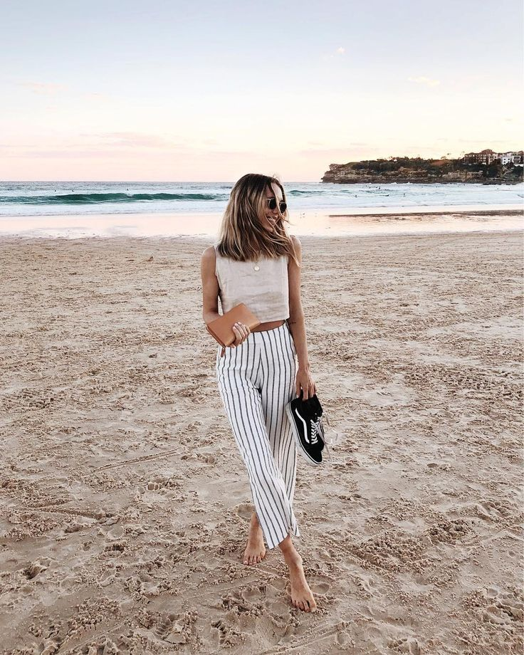 High-waisted black and white pinstriped pants for minimalist wardrobe.