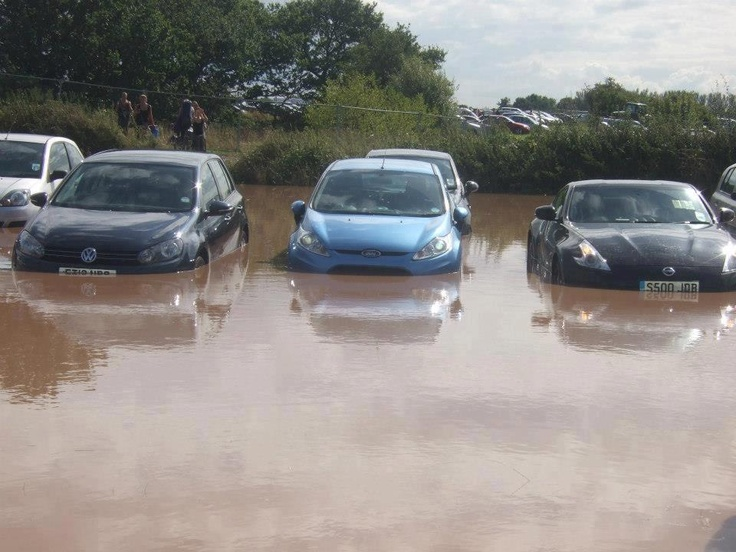 This is a picture which shows several cars being covered in water due to heavy rain at the Creamfields festival 2012. This is a very negative picture as when people see this picture they will think of mud and bad weather and may be put off attending the festival- especially due to excessive flooding.