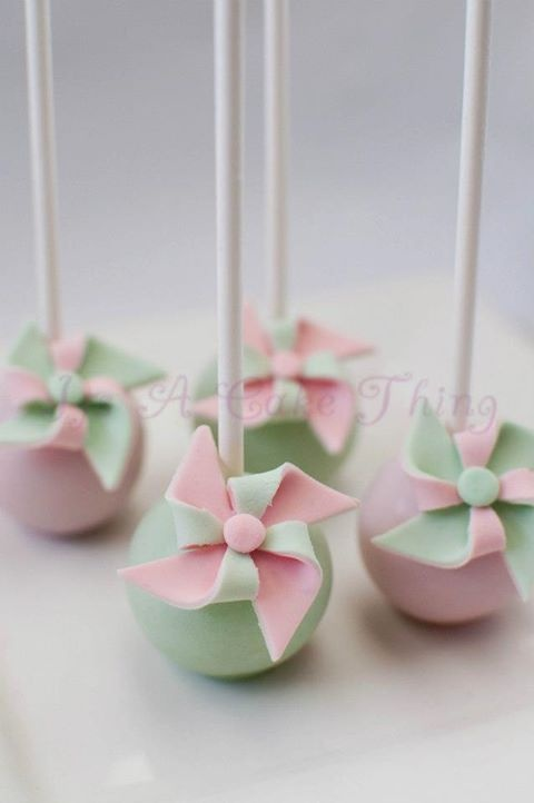 pinwheel cakes | Photo: Pinwheel cake pops to match the pink and yellow macarons for ...
