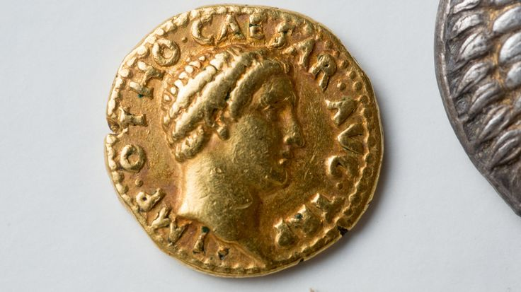 """After assistant professor Philip Kiernan at the University at Buffalo asked specialists to look at the school's rare coins, they realized the set included a """"remarkably rare"""" gold coin from the emperor Otho's short reign. Douglas Levere/University at Buffalo"""