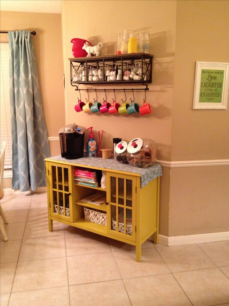 My Coffee bar / Breakfast Bar with Keurig and kcups. Shelf from Hobby Lobby, cabinet from Target.com, mugs are Fiesta. Canisters and knick-knacks found thrifting :)