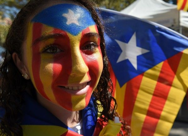 A girl with an Estelada (pro-independence Catalan flag) painted on her face…