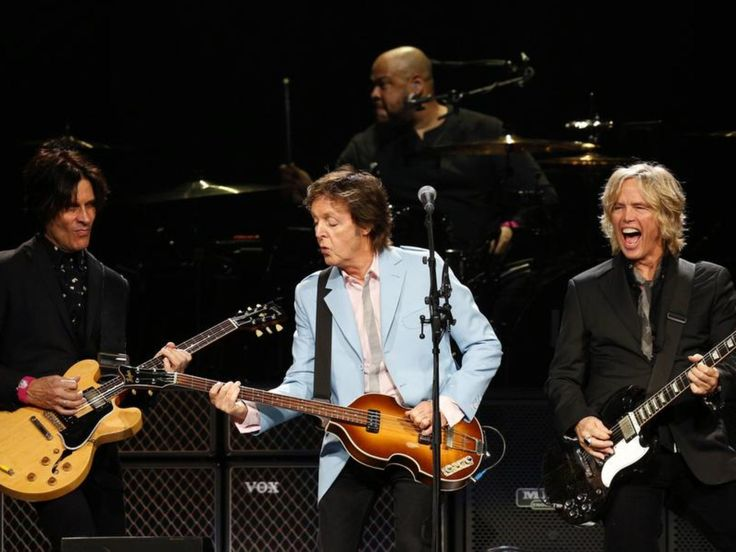 Paul McCartney rocks with his bandmates Brian Ray,