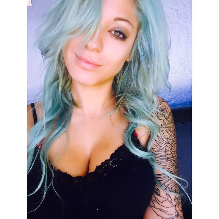 Blue hair teal hair mermaid tattoo sleeve girl