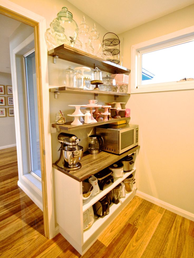 WALK IN PANTRY. Opening shelving with Diamond Gloss Laminate feature floating shelves. #kitchensbyemanuel #kbecastlehill  #kitchenideas #pantryideas #ideas #custom #local #storage #practical