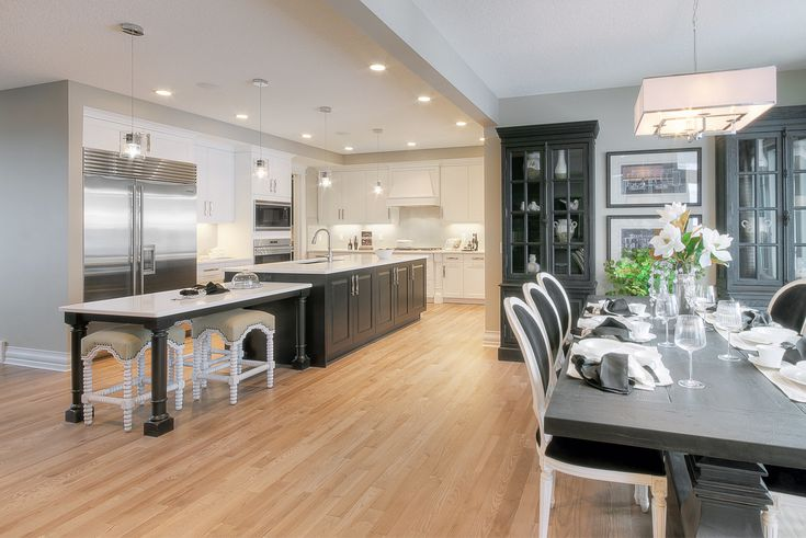 Ames #kitchen #white #dark Builder: Augusta Fine Homes Calgary; Designer: Carrie Hoffman; Finish: Fusion Prosecco; Island Finish: Maple Licorice; Doorstyle: Surrey; Island Doorstyle: Canmore; Handles: 8110-160-BSN