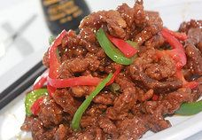 Ginger Beef or Chicken Homemade Ginger Beef Sauce mixed in Crispy Beef or Chicken.