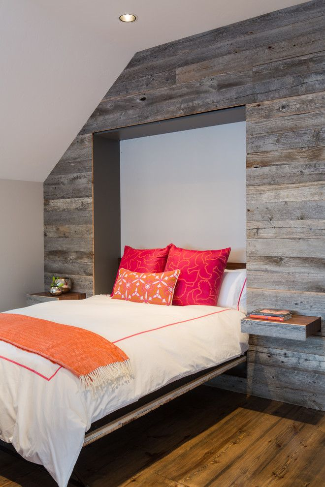 Love this accent wall of recycled wood that contains a hidden murphy bed - Great design idea...