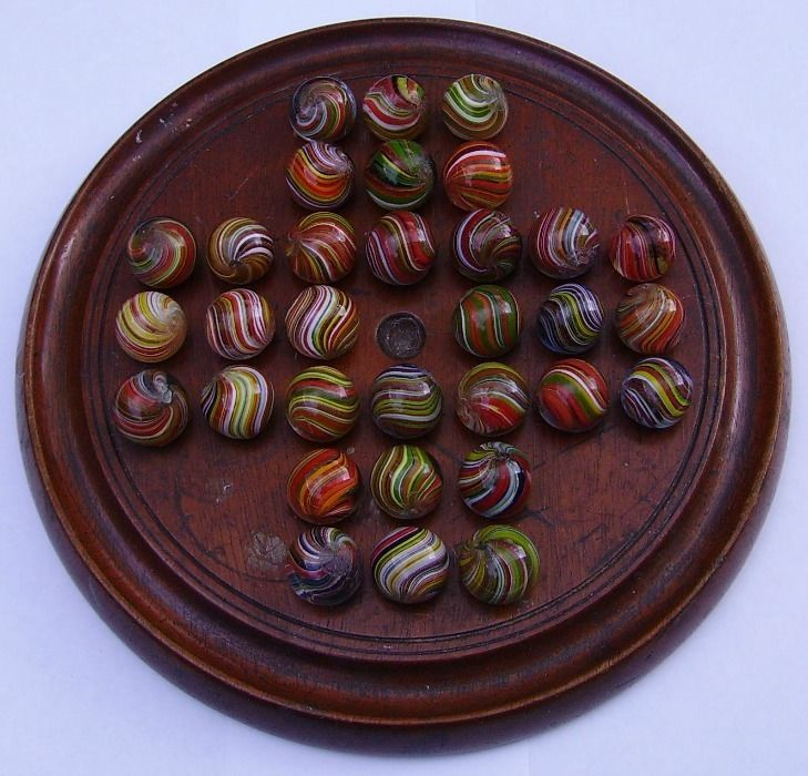 old Solitaire game with hand made glass Marbles on mahogany board  £680.02 (19B)