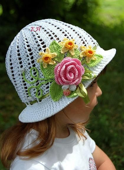 white hat with a bouquet of flowers.
