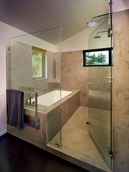 "Chadbourne enclosed the shower and tub to save space. It's covered in Milestone, an acrylic cement product. ""It's a troweled material like waterproof plaster,"" she says. ""We like it a lot because it's seamless. There are no grout lines to worry about."""