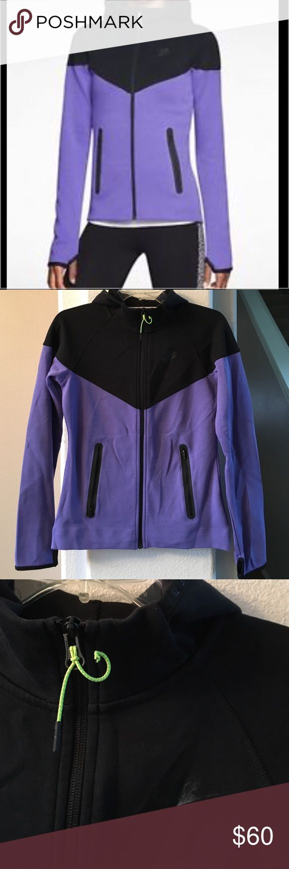 """New Listing! Nike Windrunner Tech Fleece Jacket Purple and black Nike Windrunner Tech Fleece Jacket. A cozy cotton blend and a contrast panel with chevron seams allow for warmth without the bulk and a timeless look. Multi-panel hood zips up to chin Raglan sleeves. Side pockets with bonded zippers. Elastic cuffs with thumbholes for coverage that stays in place and hand warmth Fabric: 69% cotton/31% polyester. Size small-16"""" across chest and 23"""" long. Missing one of the ends on the zipper…"""