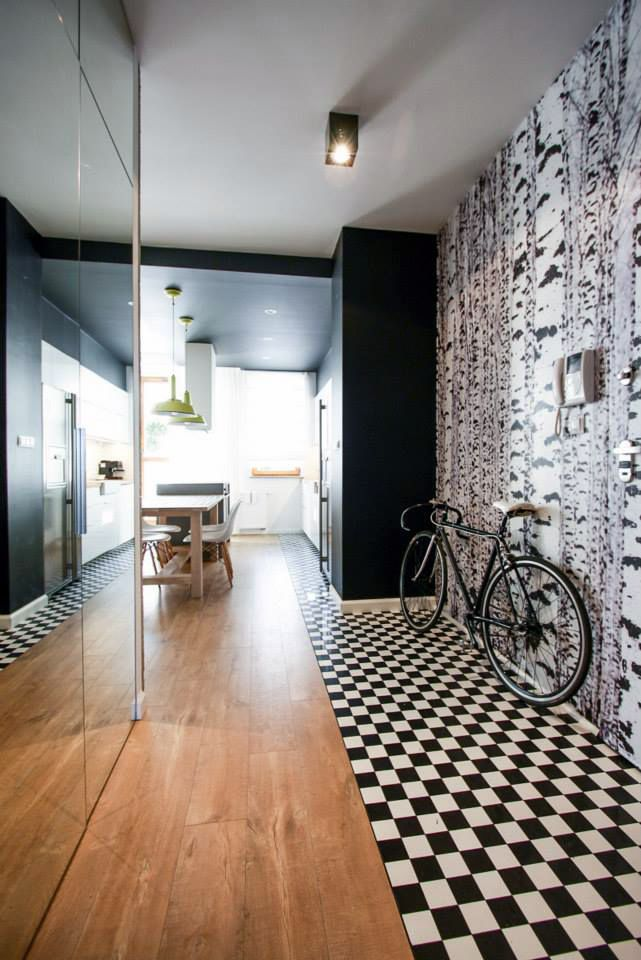 Trendy interior with a touch of retro in this apartment in Poland. The floor is a Quick-Step Perspective Wide laminate 'Natural oak with saw cuts' (UFW1548). Get inspired at www.quick-step.com