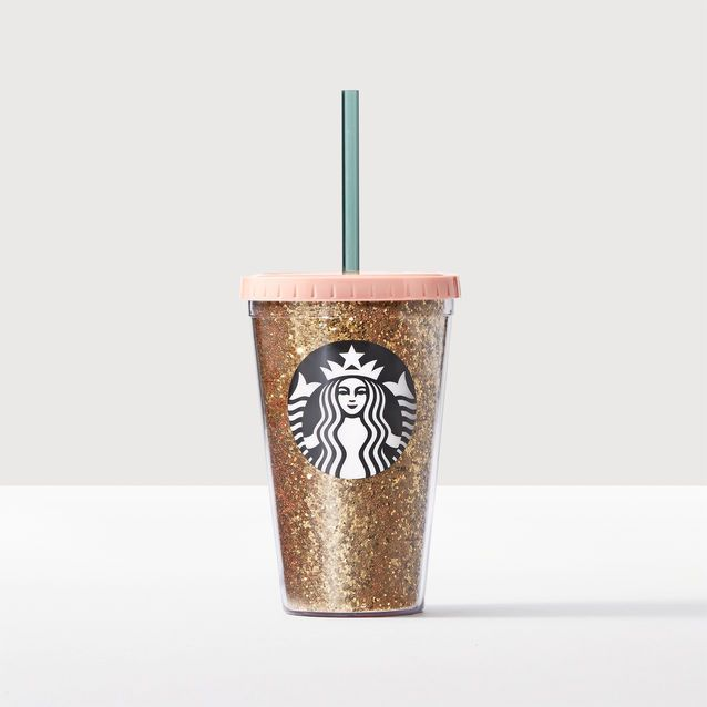 An+acrylic+Cold+Cup+tumbler+with+a+gold+glitter+art+insert+and+a+pink+quilted+lid.