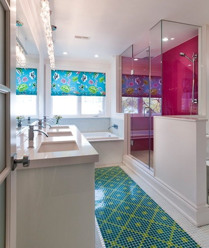 Colourful tiles in this clean and crisp bathroom.
