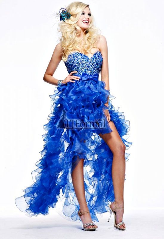 One Of A Kind Blue Prom Dress With Lots Of Feathers Coming From The