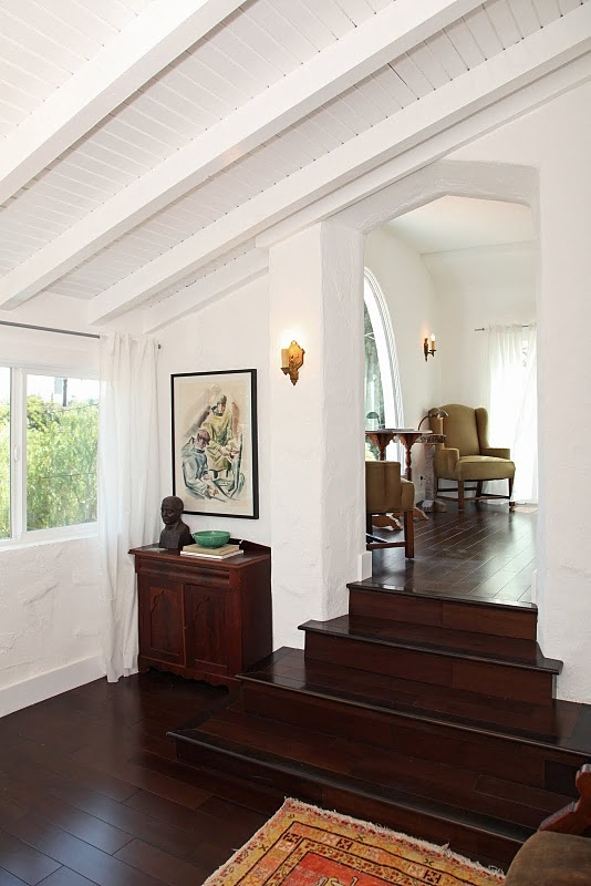spanish style. crisp white walls and dark stained floors. <3