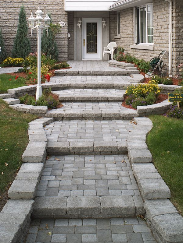Concrete paver walkway and entrance with steps
