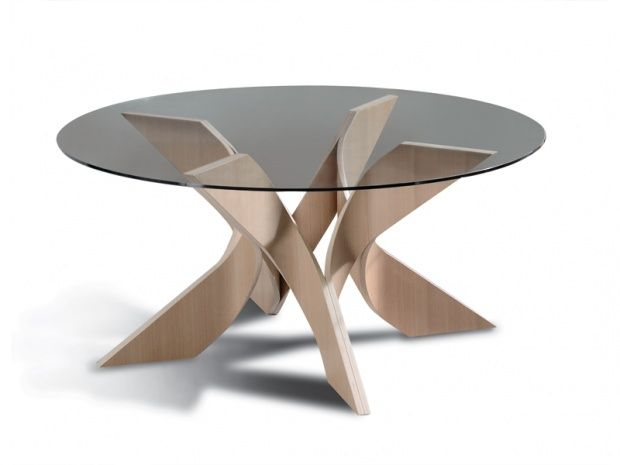STROVILOS: Greek word for whirlwind<br />Round dining table with a transparent tempered glass top, 12 mm thick, made from curved birch plywood, veneered in high quality timber such as oak or walnut ash or lacquered. This four leg table gives the opportunity of different colours and veneers.