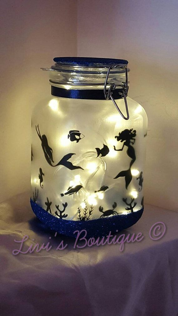 Stunning large made to order mermaid in a jar mood light / night light, come with led string lights. perfect for kids as an alternative night light in their room, as mood light around the home or to use during those summer garden parties. Glitter Base and lid can be made in any colours. Glass is hand frosted twice to ensure a complete coverage and lasting effect, design is on all four sides and different on each side. LED string lights come supplied in a choice of; White Red Purple Blue…
