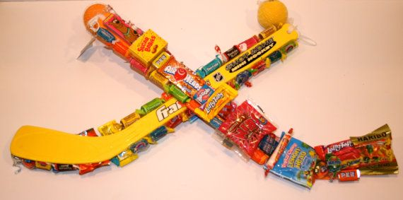 Hockey Sticks Covered In Candy!!  All candy completely edible!!  What a great gift for the Hockey Player in your life!!!!!!