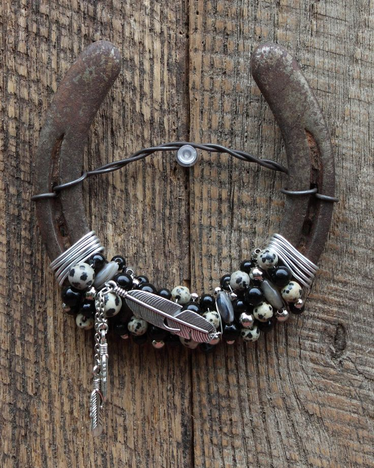 Feather Beaded Horseshoe Wall Hanging, Home Decor, Western Decor, Horseshoe Decor, Recycled Decor, Beaded Horseshoe, Equestrian Decor by WhiteFeatherJewelry on Etsy https://www.etsy.com/listing/251659267/feather-beaded-horseshoe-wall-hanging