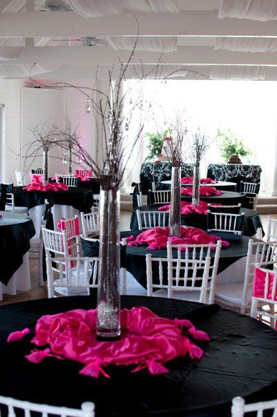 Black & Pink wedding tables. These have white chairs