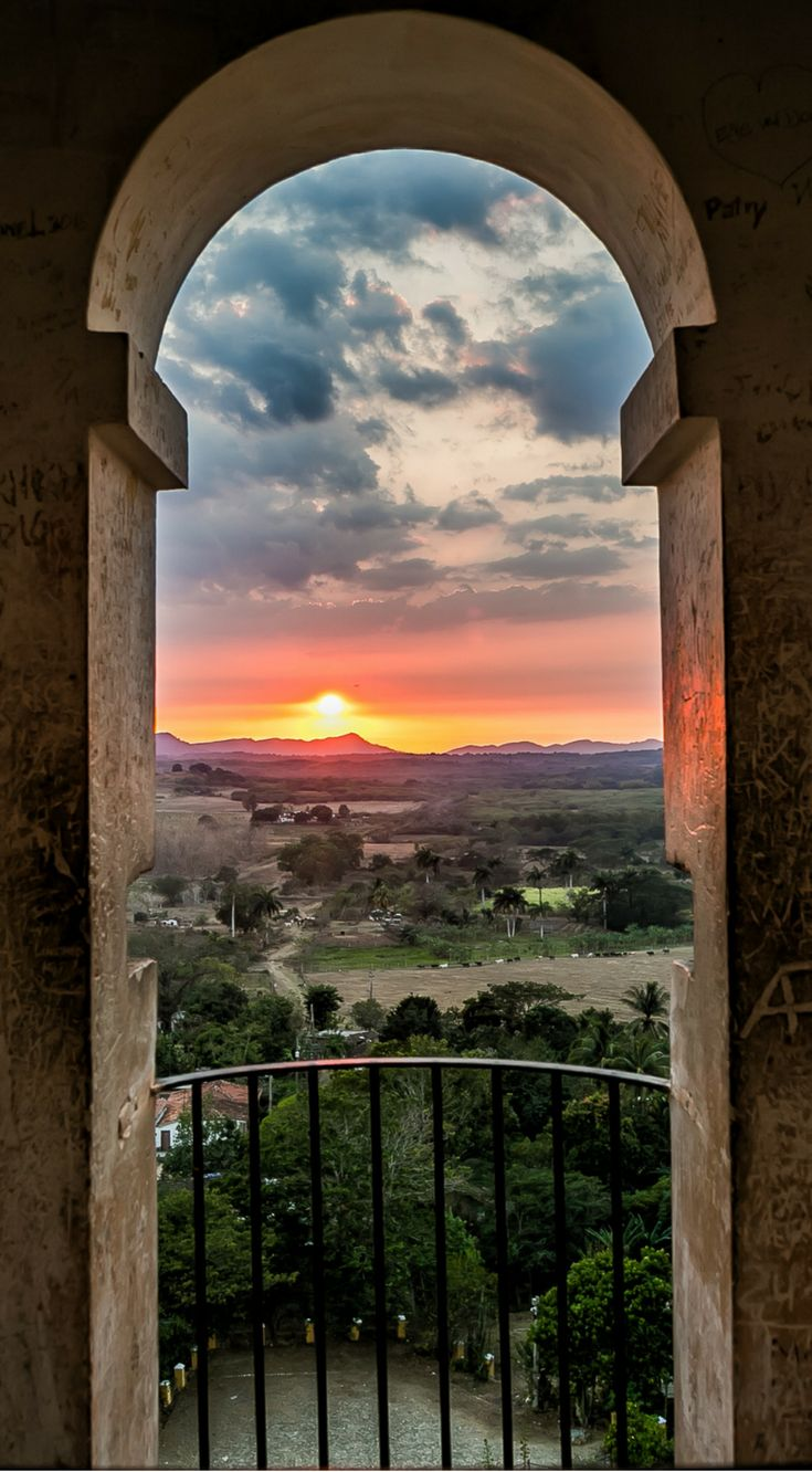 Sunset in Trinidad, Cuba over the sugarcane fields. The photo was taken By Lina Stock on the Divergent Travelers Photography Tour in Cuba. The Divergent Travelers Adventure Travel blog showcases great stories and some of the best travel photography in the
