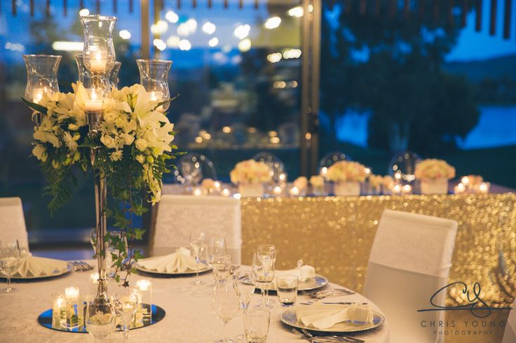 Wedding table arrangements, wedding decorations romantic - Stunning tall candelabra with flower arrangement and bridal table with gold sequins and loads of candlelight at Josef Chromys Vineyard, Launceston