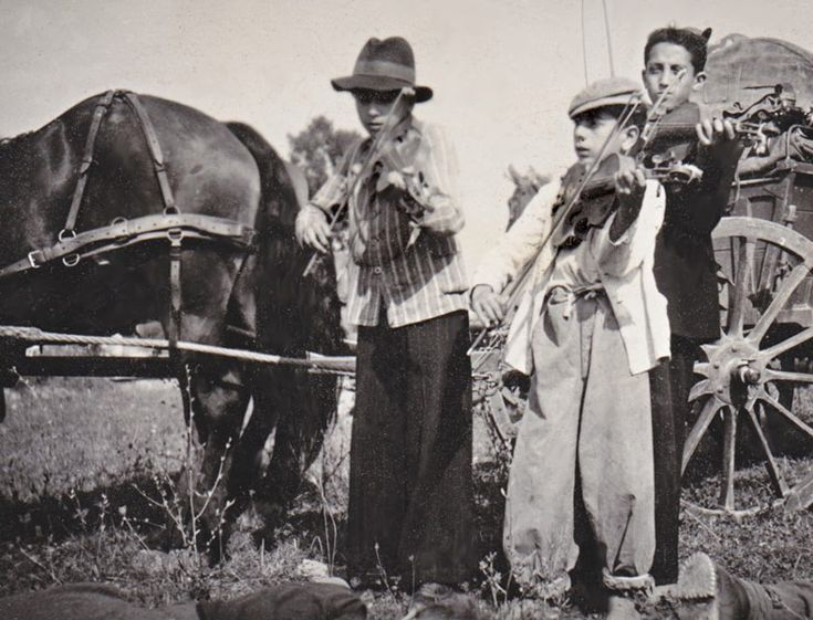 Poland. Young nomadic Gypsy violinists. The beginning of 1940s.