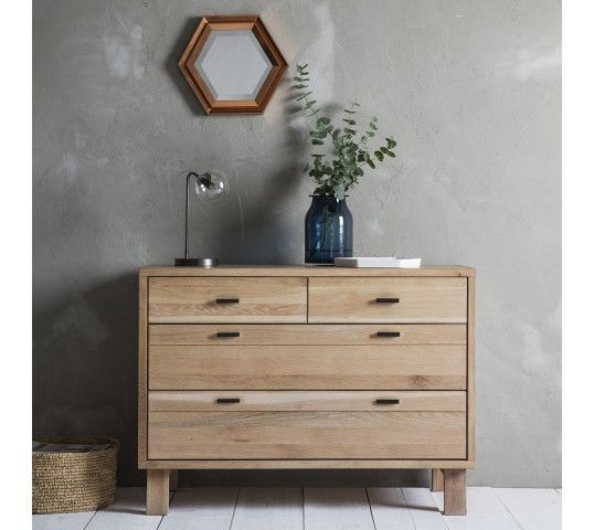 Simple in design, a truly solid and contemporary style that is crafted with beautifully mellow solid Oak, with white hues to add a sense of calm and serenity. The stunning Kielder 2+2 Drawer Chest has defined lines, a contemporary and fresh design and boasts hand crafted brass handles to the drawers that are both practical and unique in look. This piece would be a stylish addition to any bedroom.