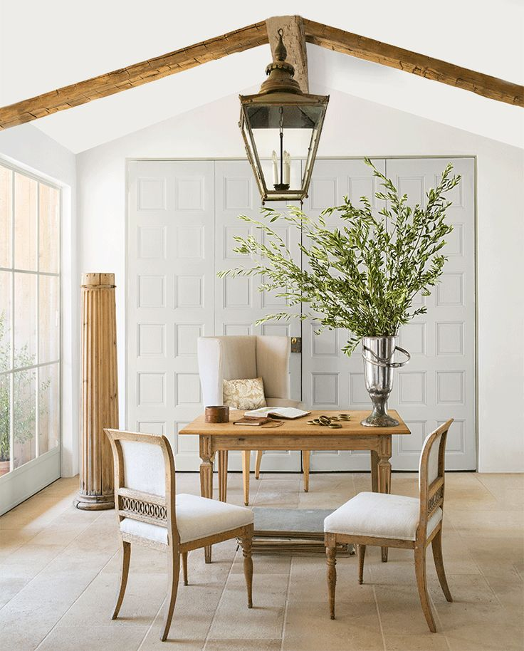 Tee unfussy, quiet hued modern farmhouse style decor in the office of Brooke Giannetti at Patina Farm is a luxurious riff on European country style and California cozy. Rustic ceiling beams, oversized hanging lantern, and European antiques live happily together with light grey painted vintage doors. #PatinaFarm #modernfarmhouse #homeoffice