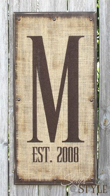 Personalized monogram burlap/wood sign - the one pictured is for sale.  You could very easily make one for under $5 dollars (saving you a whopping $57.48!) with a piece of scrap wood, burlap, brown craft paint, a few nails or upholstery tacks and stencils.