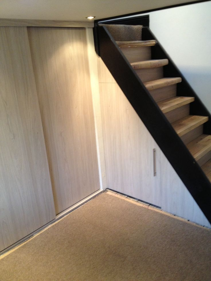 Bespoke bedroom storage under stairs