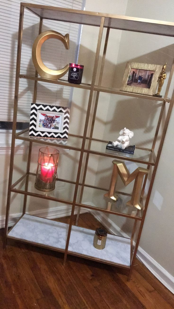 Ikea bookshelf make over with gold spray and marble contact paper