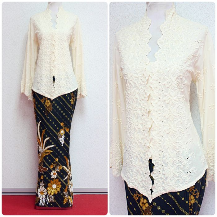 Kebaya Karla II in cream colour, with full beads embroidery paired with full sequins skirt is available in XL size. More at www.empireofelegance.com.my
