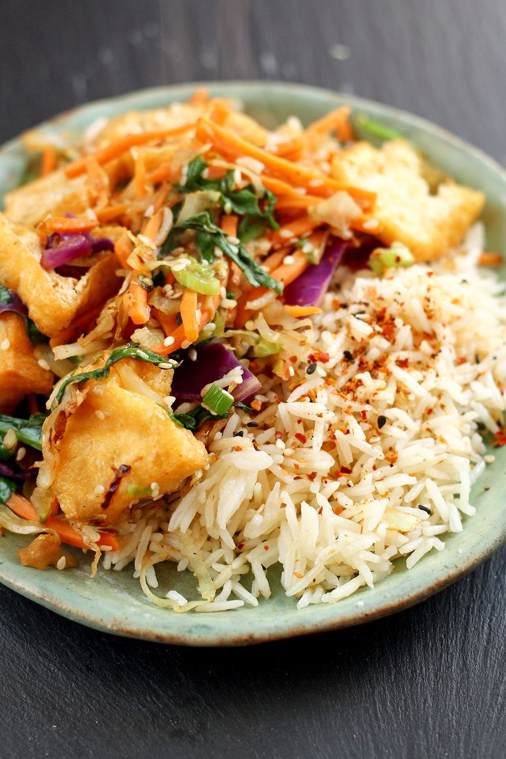 """garden-of-vegan: """" Sliced deep-fried tofu puffs, shredded cabbage, matchstick carrots and spinach with black bean sauce + soy sauce + basmati rice topped with shichimi togarashi spice blend. """""""