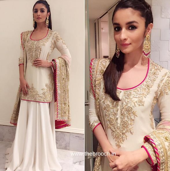 Alia Bhatt in Abu Jani Sandeep Khosla attended Masaba Gupta's wedding reception. Styled by Ami Patel. Another classy with beautiful golden embroidered work piece by the duo designer. Finishing the look with matching statement earring. Liking the hair and makeup here. FAB!