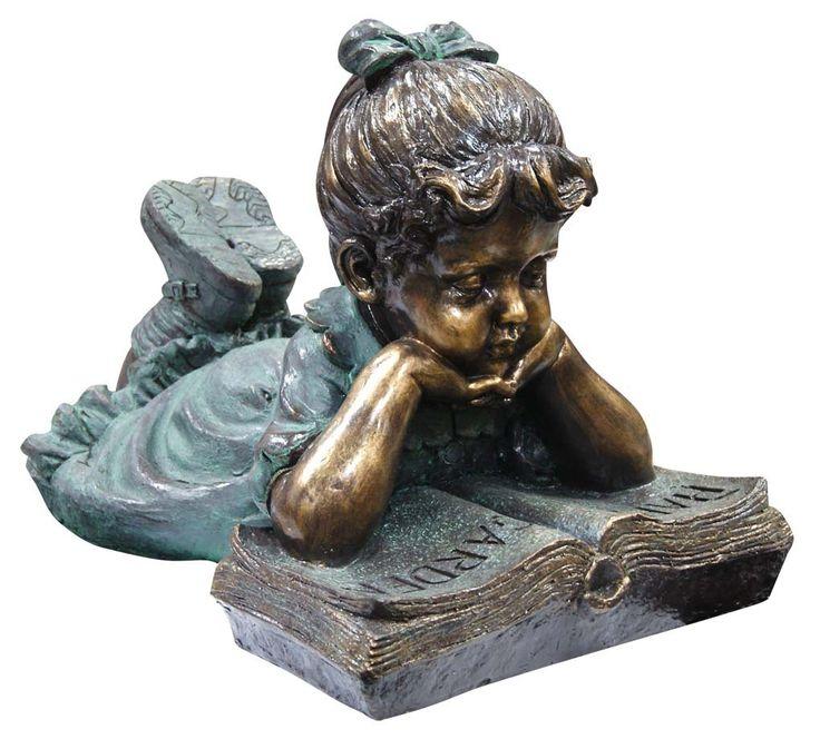Girl reading a book garden statue.