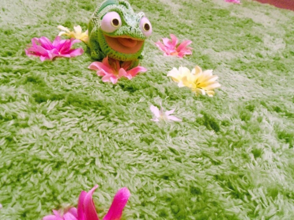 Green shag rug with fake flowers attached with dental floss.  Tangled inspired theme.