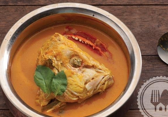 GULAI KEPALA IKAN. Snapper heads cooked in richly turmeric spiced coconut soup with consistent and smooth texture from the well-blended spice paste. This is a popular dish from West Sumatra.
