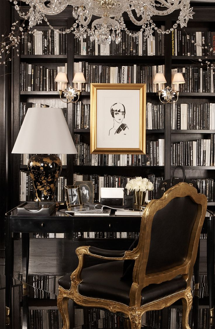A Ralph Lauren Home black and white study finds allure in gold touches from the Black Gable Table Lamp and the Indian Cove Lodge Fauteuil.