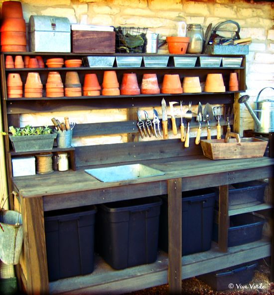Potting area. Great idea with the tubs and bowls under the bench to hold different types of compost/soil. J
