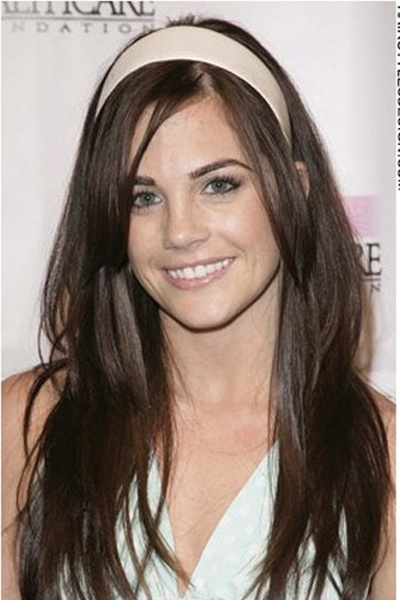 Jillian Murray's hair is long and straight. The hair is thick with bangs down at the forehead. This style is cute and fresh.